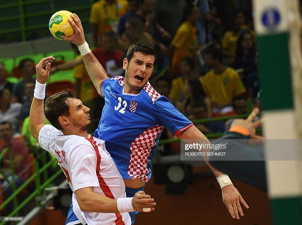 Poland's right back Krzysztof Lijewski vies with Croatia's left back Ivan Sliskovic during the men's quarterfinal handball match Croatia vs poland...