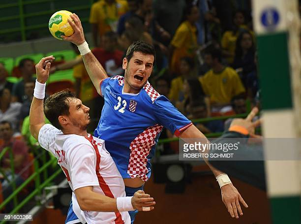 Poland's right back Krzysztof Lijewski vies with Croatia's left back Ivan Sliskovic during the men's quarterfinal handball match Croatia vs poland...