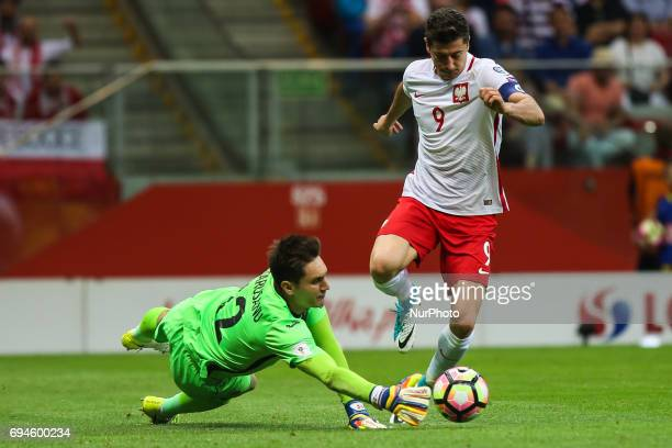 Poland's Robert Lewandowski and Romania's goalkeeper Ciprian Tatarusanu vie for the ball during the FIFA World Cup 2018 qualification football match...