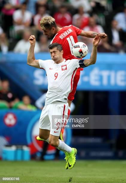 Poland's Robert Lewandowski and Switzerland's Valon Behrami battle for the ball