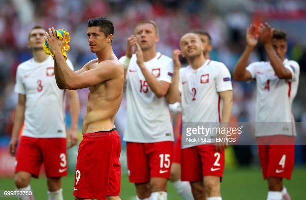 Poland's Robert Lewandowski applauds the fans after the final whistle