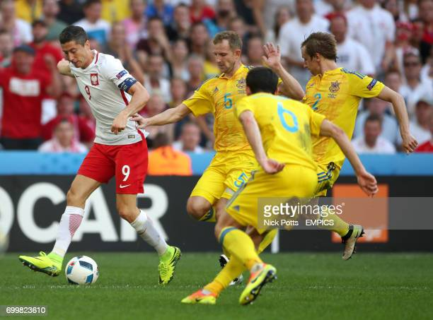 Poland's Robert Lewandowski breaks through the Ukraine defence