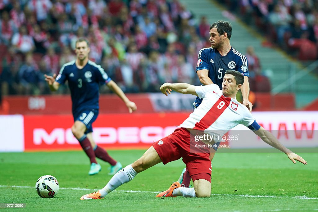 Poland's Robert Lewandowski fights for the ball with Gordon Greer of Scotland during the UEFA EURO 2016 qualifying match between Poland and Scotland...