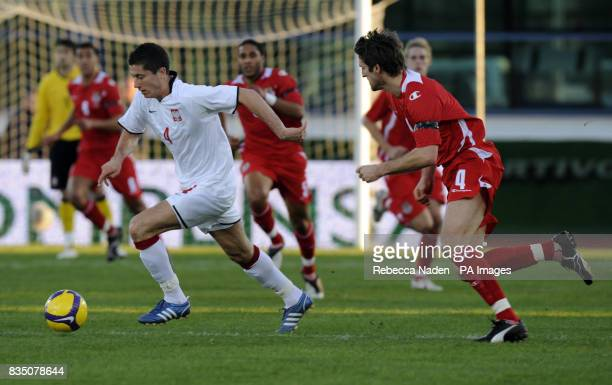 Poland's Robert Lewandowski in action with Wales' Samuel Ricketts during the International Friendly at the Vila Real De Santo Antonio Sports Complex...