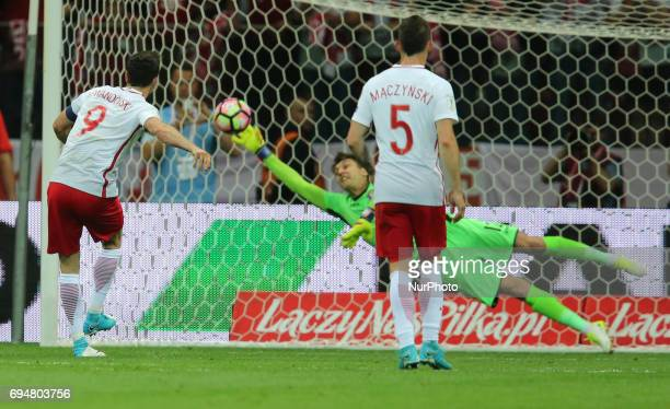 Poland's Robert Lewandowski scores a penalty against Ciprian Tatarusanu of Romania during the FIFA World Cup 2018 qualification football match...