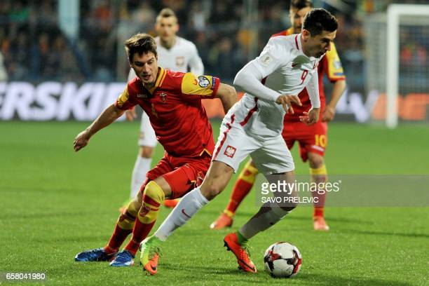 Poland's Robert Lewandowski vies with Montenegro's Nikola Vukcevic during the FIFA World Cup 2018 qualification football match between Montenegro and...