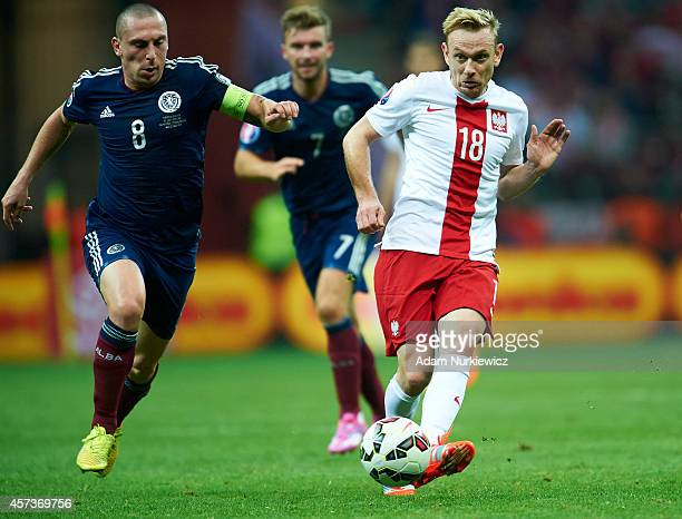 Poland's Sebastian Mila fights for the ball with Scott Brown of Scotland during the UEFA EURO 2016 qualifying match between Poland and Scotland on...