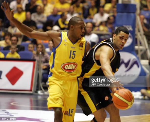 Poland's Sopot Christian Dalmau fights for the ball against Maccabi Tel Aviv's Will Solomon during their Euroleague match at the Yad Eliyahu areana...