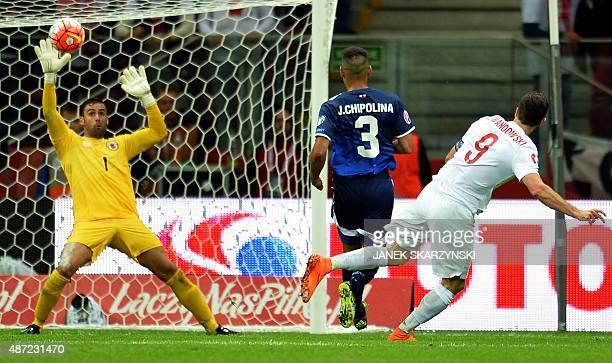 Poland's striker Robert Lewandowski fails to score past Gibraltar's goalkeeper Jordan Perez during the UEFA Euro 2016 qualifying football match...