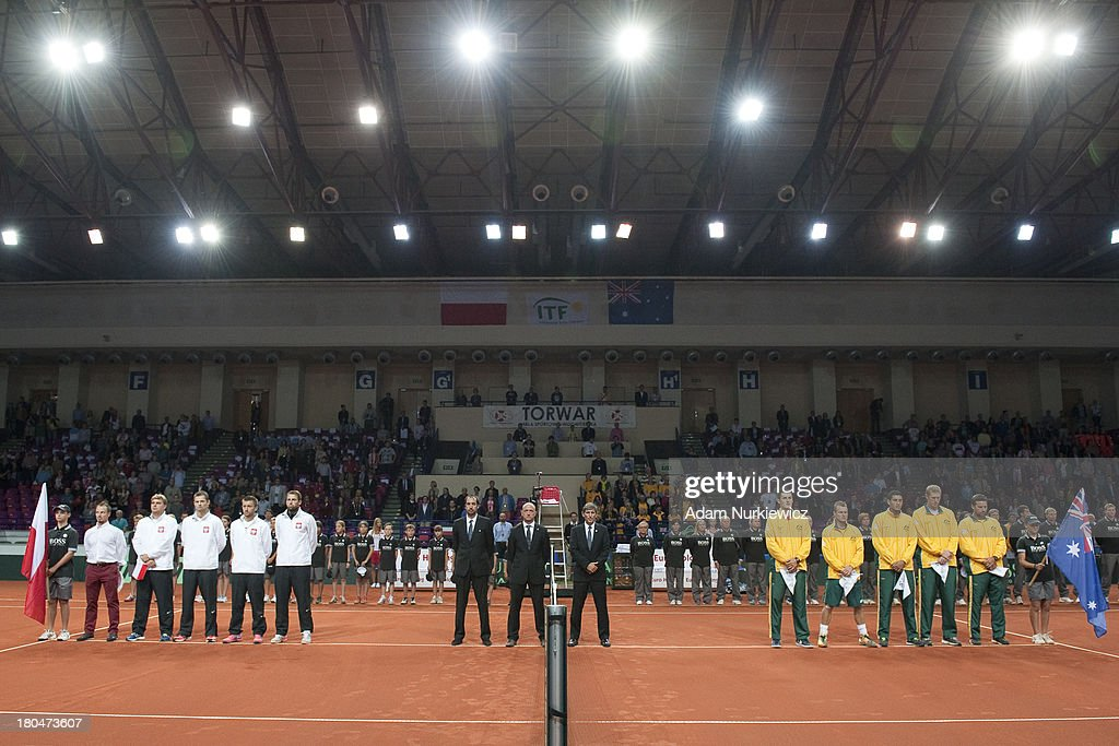 Poland's team and Australia's team while national anthems before the Davis Cup match between Poland and Australia at the Torwar Hall, on September 13, 2013 in Warsaw, Poland.