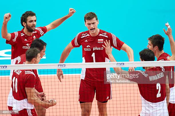 Poland's team celebrate winning the point during the FIVB World Championships SemiFinal match between Germany and Poland at Spodek Hall on September...