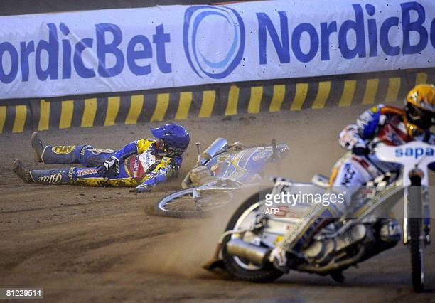 Poland's Tomasz Gollob falls from his motorcycle behind Sweden's Fredrik Lindgren right during their speedway Grand Prix race at Ullevi Arena May 24...