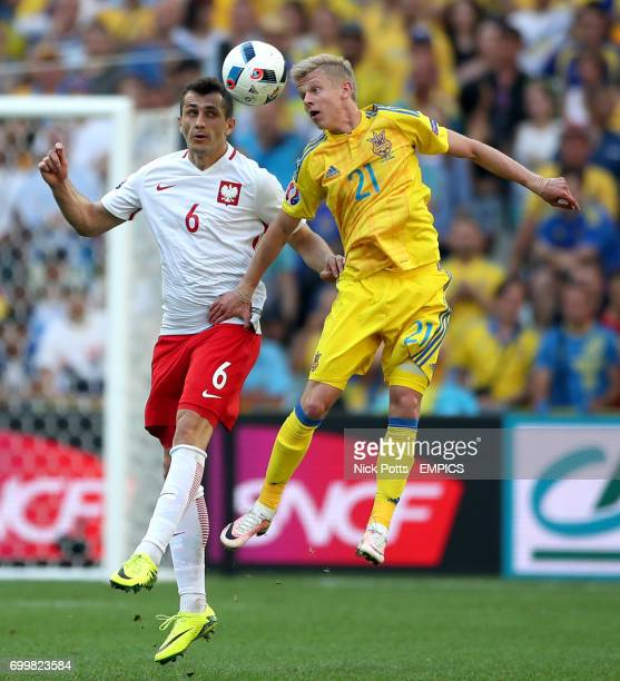 Poland's Tomasz Jodlowiec and Ukraine's Oleksandr Zinchenko battle for the ball
