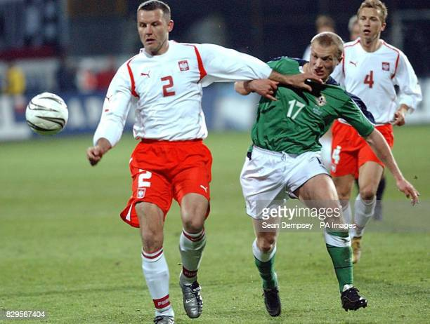 Poland's Tomasz Klos battles for the ball with Northern Ireland's Thomas Doherty