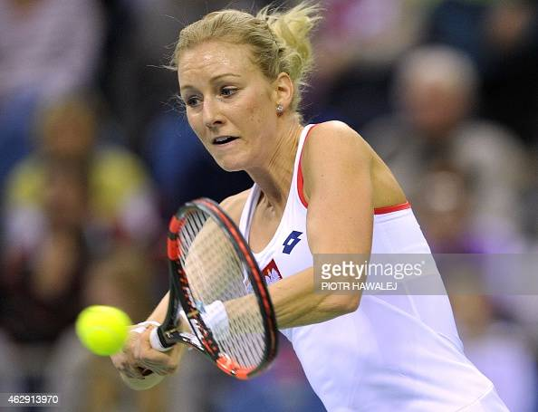 Poland's Urszula Radwanska returns the ball to Russia's Maria Sharapova during their Fed Cup World Group tennis match between Poland and Russia in...