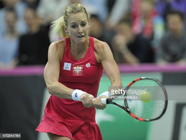 Poland's Urszula Radwanska returns the ball to Switzerland's Martina Hingis during the International Tennis Federation Cup World Group play off match...