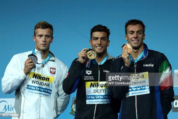 Poland's Wojcieh Wojdak Italy's Gabriele Detti and Italy's Gregorio Paltrinieri pose during the podium ceremony for the men's 800m freestyle final...
