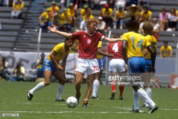 Poland's Zbigniew Boniek remonstrates with the Brazil players