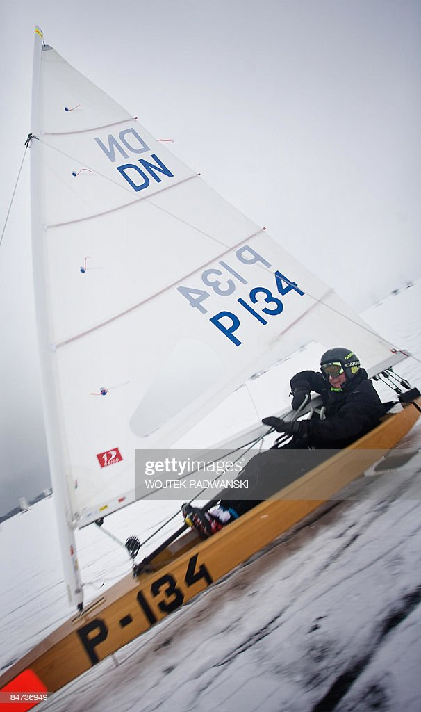 'Poland-sports-extreme-sail' A DN class type Iceboat sails on a frozen lake Sniardwy - Polands largest lake, in northern Poland on January 31, 2009. 'It's the speed that gives you an adrenaline rush,' says skipper Tomasz Zakrzewski (not pictured), ranked number fourth in the world in the DN class of ice boat racing. Sleek and built for speed, narrow boat hulls are fixed on a base of three gleaming blades and sport a sail typical of sail boards to harness the power of the wind and so roar across frozen lakes. Clad in protective goggles and crash helmets, ice boat competitors also wear neon-coloured life jackets just in case the ice cracks.
