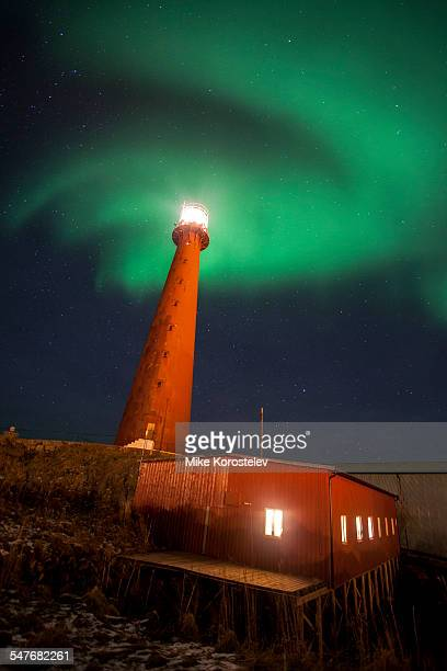 Polar lights and a lighthouse, Norway, Andenes
