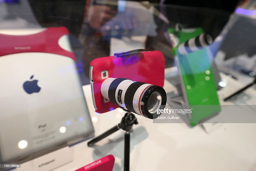 A Polaroid lens adapter for an iPhone is displayed during the 2013 International CES at the Las Vegas Convention Center on January 8, 2013 in Las Vegas, Nevada. CES, the world's largest annual consumer technology trade show, runs from January 8-11 and is expected to feature 3,100 exhibitors showing off their latest products and services to about 150,000 attendees.