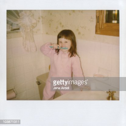 Polaroid of a little girl brushing her teeth : Stock Photo