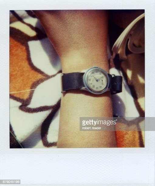 Polaroid photograph of watch on wrist