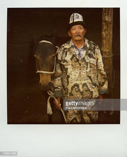 Polaroid Picture Of An Old Man With His Horse in Kyrgyzstan