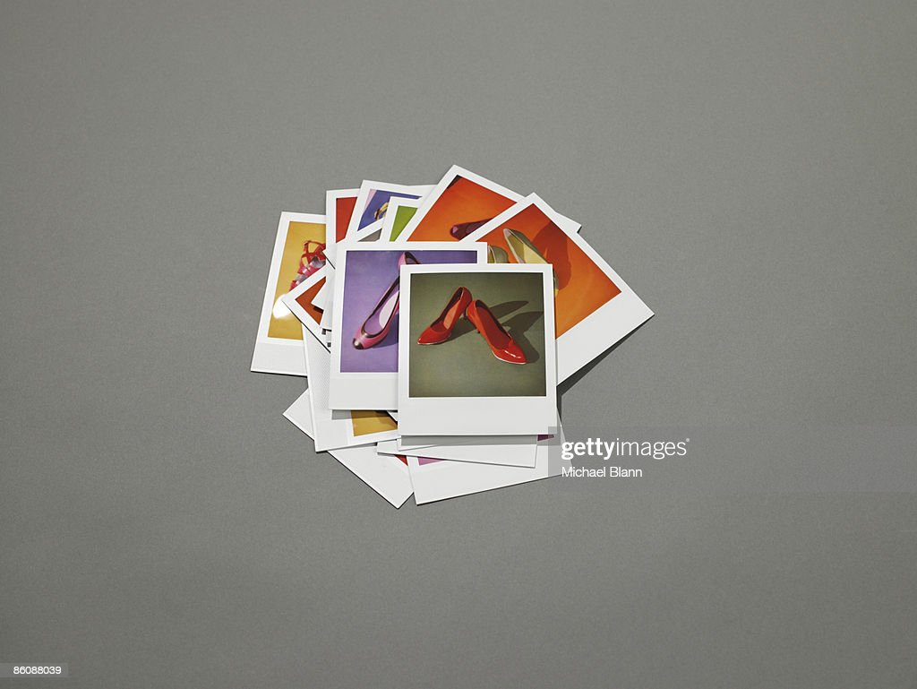 Polaroids of shoes on the ground : Stock Photo