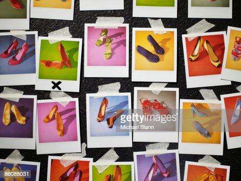Polaroids of shoes taped to wall : Stock Photo