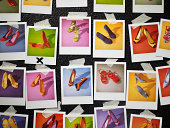 Polaroids of shoes taped to wall