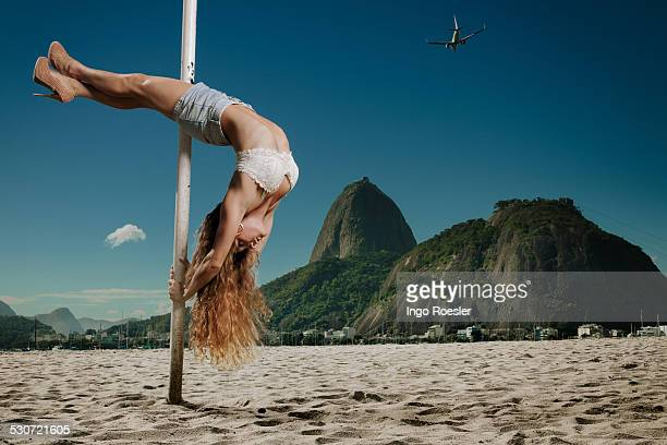 Pole dancer performs at the beach