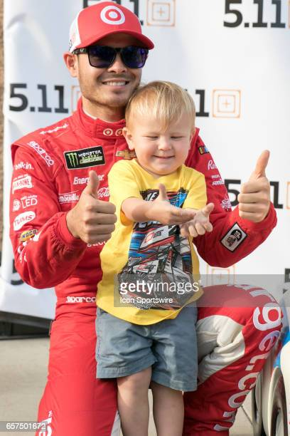 Pole Day Winner Kyle Larson poses with his son Owen after qualifying first for the Auto Club 400 NASCAR Monster Energy Cup Series race on March 24...