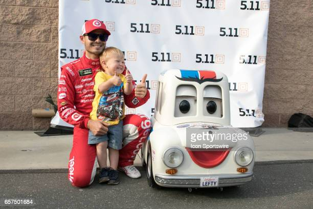 Pole Day Winner Kyle Larson poses with his son Owen and the Auto Club Speedway mascot 'Lefty' after qualifying first for the Auto Club 400 NASCAR...