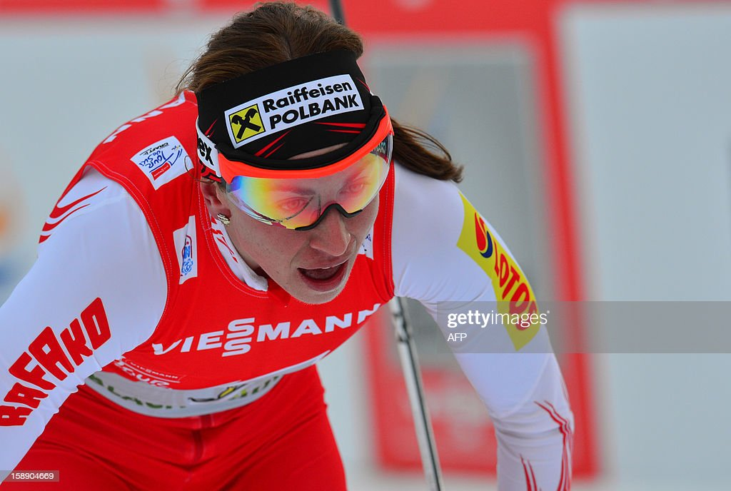 Pole Justyna Kowalczyk celebrates as she crosses the finish line of women's Tour de Ski , Stage four, 15km free pursuit in Toblach on January 3, 2013. Kowalczyk won ahead of Charlotte Kalla of Sweden and Therese Johaug of Norway .