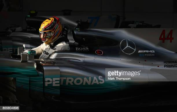 Pole position qualifier Lewis Hamilton of Great Britain and Mercedes GP stops in parc ferme during qualifying for the Malaysia Formula One Grand Prix...