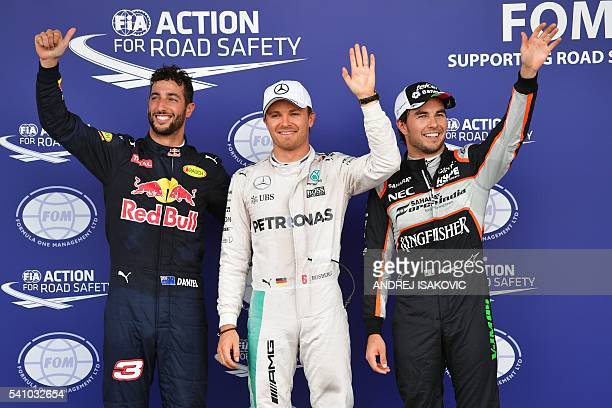 Pole position winner Mercedes AMG Petronas F1 Team's German driver Nico Rosberg celebrates next to second placed Sahara Force India F1 Team's Mexican...