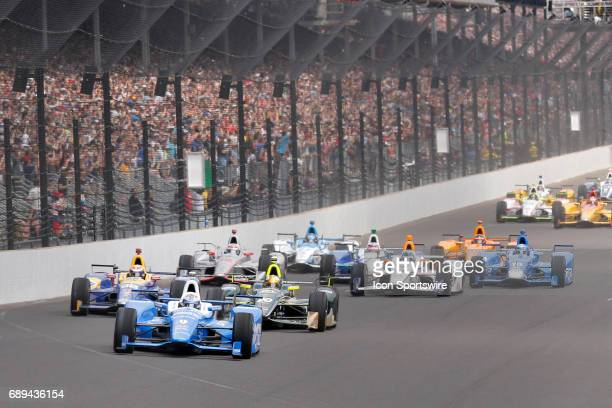 Pole setter Indycar driver Scott Dixon of Chip Ganassi Racing leads the field into turn on at the start of the 101st running of the Indianapolis 500...