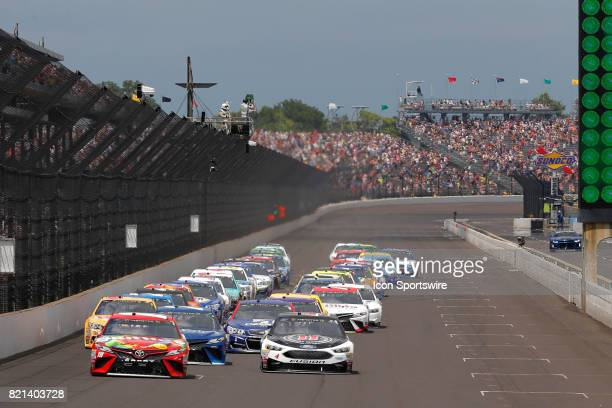 Pole setter Kyle Busch Joe Gibbs Racing Toyota Camry leads the field to the green flag to start the NASCAR Monster Energy Cup Series Brantley Gilbert...