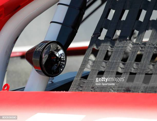 Pole sitter Kyle Larson is seen thru his side view mirror before the start of the NASCAR Monster Energy Cup Series Toyota/Save Mart 350 on June 25...