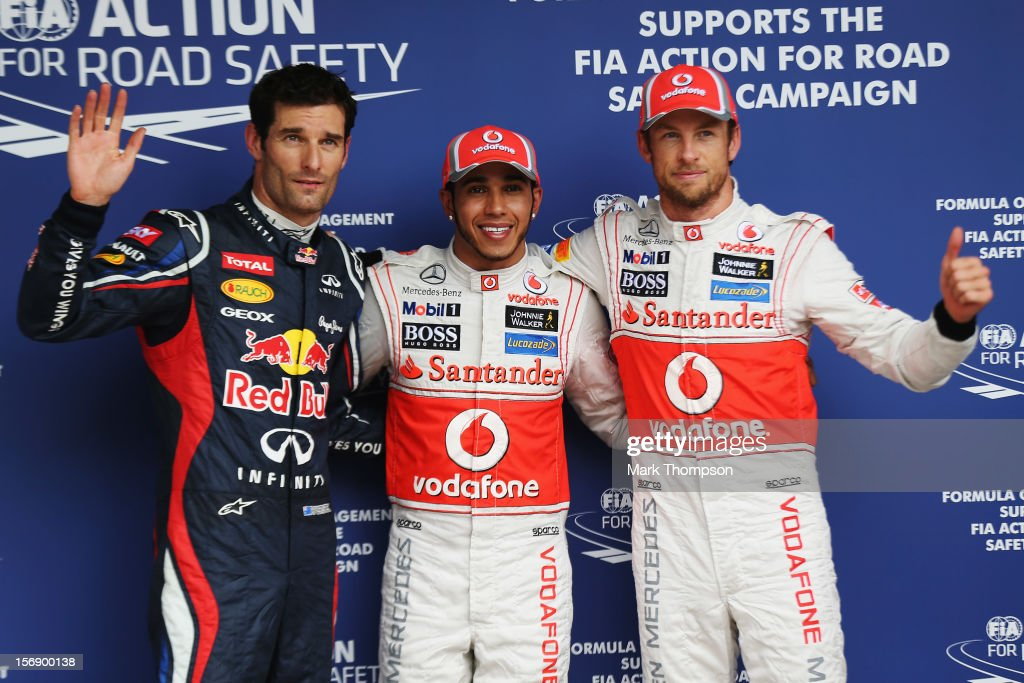 Pole sitter <a gi-track='captionPersonalityLinkClicked' href=/galleries/search?phrase=Lewis+Hamilton+-+Racecar+Driver&family=editorial&specificpeople=586983 ng-click='$event.stopPropagation()'>Lewis Hamilton</a> (C) of Great Britain and McLaren celebrates with second placed <a gi-track='captionPersonalityLinkClicked' href=/galleries/search?phrase=Jenson+Button&family=editorial&specificpeople=171505 ng-click='$event.stopPropagation()'>Jenson Button</a> (R) of Great Britain and McLaren and third placed <a gi-track='captionPersonalityLinkClicked' href=/galleries/search?phrase=Mark+Webber+-+Race+Car+Driver&family=editorial&specificpeople=167271 ng-click='$event.stopPropagation()'>Mark Webber</a> (L) of Australia and Red Bull Racing following qualifying for the Brazilian Formula One Grand Prix at the Autodromo Jose Carlos Pace on November 24, 2012 in Sao Paulo, Brazil.