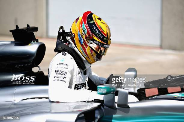 Pole sitter Lewis Hamilton of Great Britain and Mercedes GP climbs out of his car in parc ferme during qualifying for the Canadian Formula One Grand...