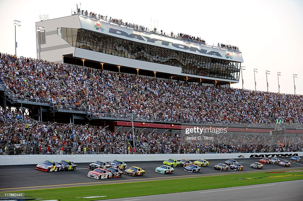 Pole sitter Mark Martin driver of the Carquest/GoDaddycom Chevrolet and Trevor Bayne driver of the Motorcraft/Quick Lane Tire Auto Center Ford lead...