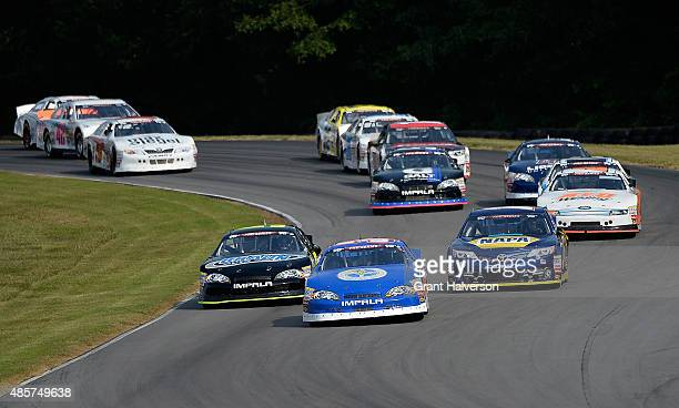Pole sitter Scott Heckert driver of the Project Lifesaver Chevrolet leads the field into the first set of turns on the first lap of the NASCAR KN Pro...