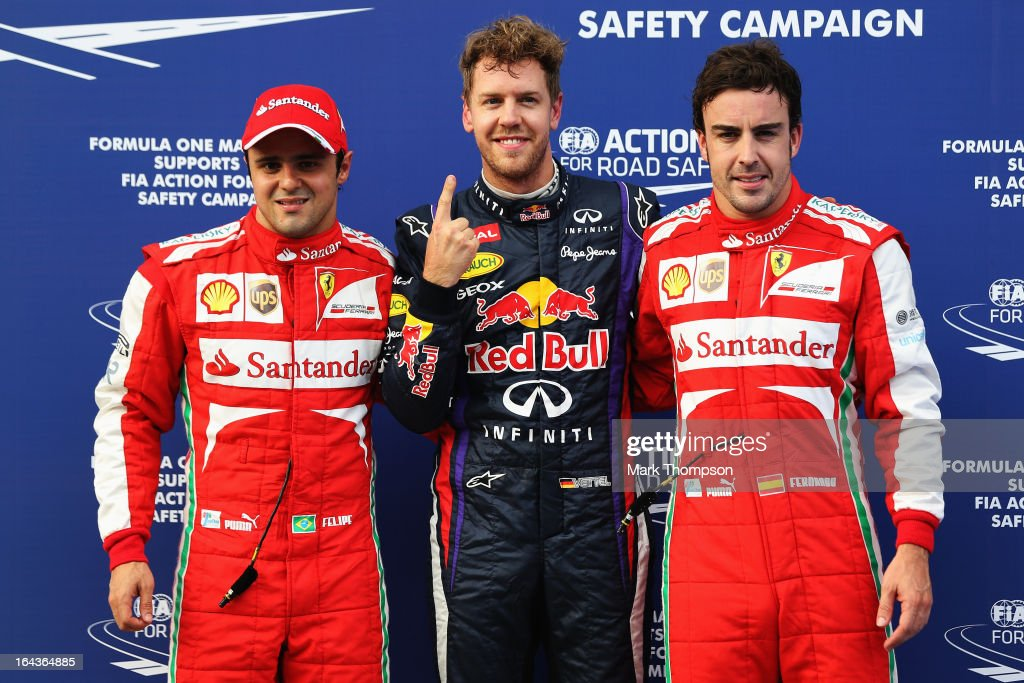 Pole sitter <a gi-track='captionPersonalityLinkClicked' href=/galleries/search?phrase=Sebastian+Vettel&family=editorial&specificpeople=2233605 ng-click='$event.stopPropagation()'>Sebastian Vettel</a> (C) of Germany and Infiniti Red Bull Racing celebrates with second placed <a gi-track='captionPersonalityLinkClicked' href=/galleries/search?phrase=Felipe+Massa&family=editorial&specificpeople=206660 ng-click='$event.stopPropagation()'>Felipe Massa</a> (L) of Brazil and Ferrari and third placed Fernando Alonso (R) of Spain and Ferrari following qualifying for the Malaysian Formula One Grand Prix at the Sepang Circuit on March 23, 2013 in Kuala Lumpur, Malaysia.