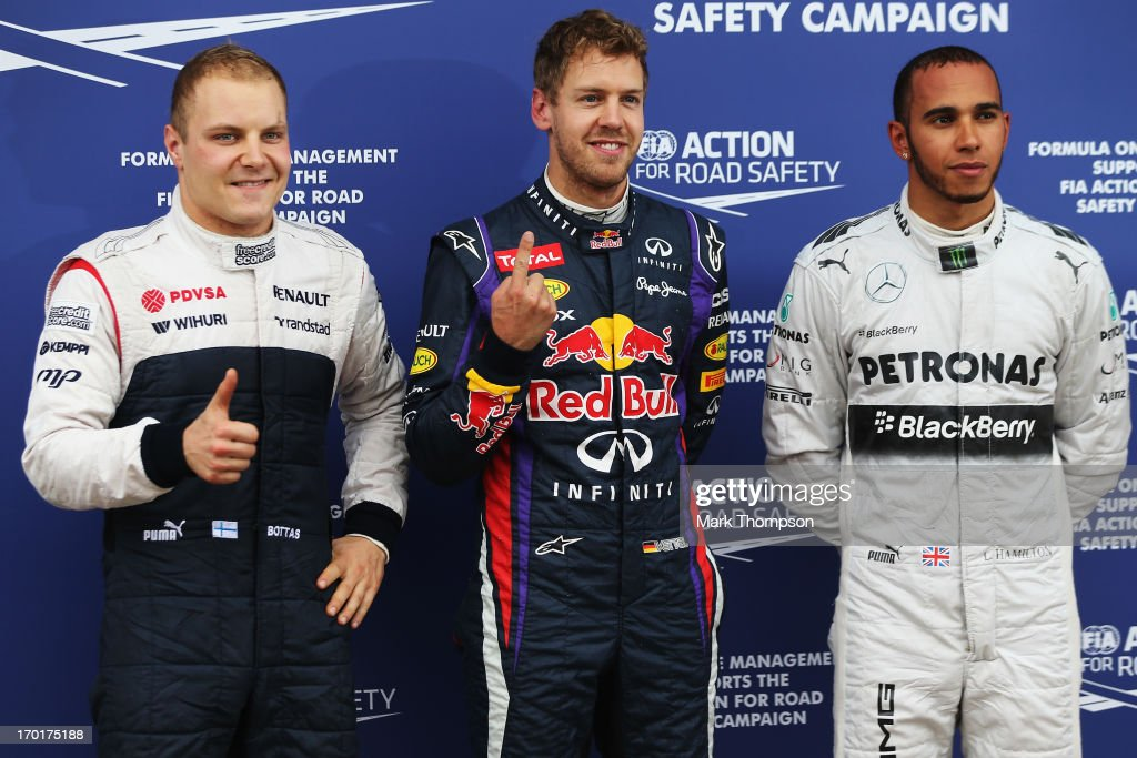 Pole sitter <a gi-track='captionPersonalityLinkClicked' href=/galleries/search?phrase=Sebastian+Vettel&family=editorial&specificpeople=2233605 ng-click='$event.stopPropagation()'>Sebastian Vettel</a> (C) of Germany and Infiniti Red Bull Racing celebrates in parc ferme with second placed <a gi-track='captionPersonalityLinkClicked' href=/galleries/search?phrase=Lewis+Hamilton+-+Racecar+Driver&family=editorial&specificpeople=586983 ng-click='$event.stopPropagation()'>Lewis Hamilton</a> (R) of Great Britain and Mercedes GP and third placed <a gi-track='captionPersonalityLinkClicked' href=/galleries/search?phrase=Valtteri+Bottas&family=editorial&specificpeople=8640136 ng-click='$event.stopPropagation()'>Valtteri Bottas</a> (L) of Finland and Williams following qualifying for the Canadian Formula One Grand Prix at the Circuit Gilles Villeneuve on June 8, 2013 in Montreal, Canada.