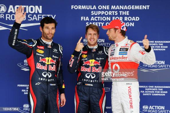 Pole sitter Sebastian Vettel of Germany and Red Bull Racing celebrates in parc ferme with second placed Mark Webber of Australia and Red Bull Racing...