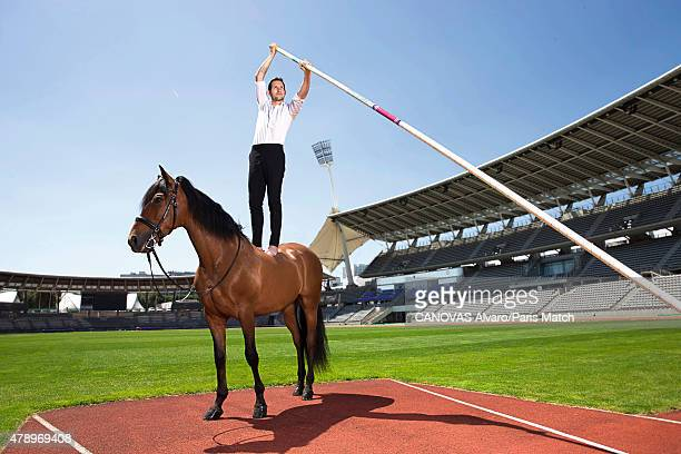 Pole vaulter and world record holder Renaud Lavillenie is photographed for Paris Match with Tarento a horse trained by Mario Luraschio June 8 2015 in...