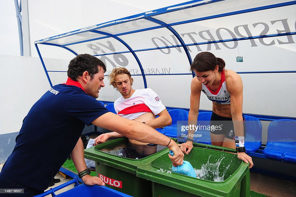 Pole Vaulter Kate Dennison (r) and long jumper Chris Tomlinson take an ice bath after their training sessions during the Team GB Track and Field preperation camp at Monte Gordo Stadium on July 25, 2012 in Monte Gordo, Portugal.