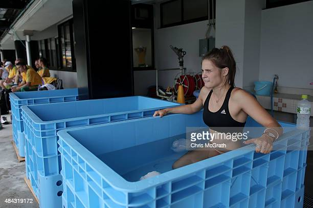 Pole vaulter Nina Kennedy of Australia takes an ice bath during the Australian Flame Team Camp training session held at Kimidera Athletics Stadium on...